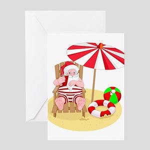 beach santa claus Greeting Cards