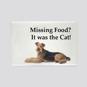 Airedale Terrier blaming missing food on t Magnets