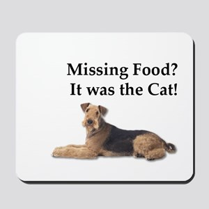 Airedale Terrier blaming missing food on Mousepad