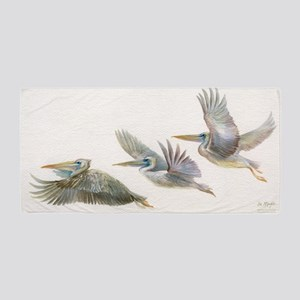 3 Pelicans Flying Beach Towel