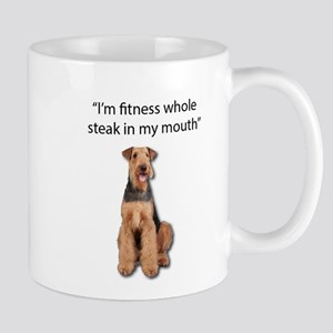 Airedale Terrier's exercise is eating. Mugs
