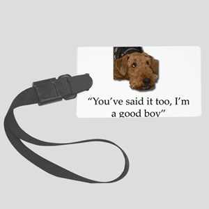 Sulking Airedale Terrier Giving Large Luggage Tag