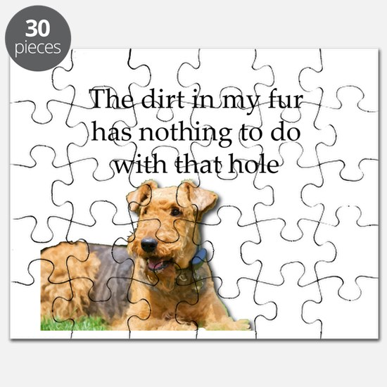 Airedale Sees no connection between his hol Puzzle