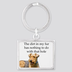 Airedale Sees no connection between his Keychains