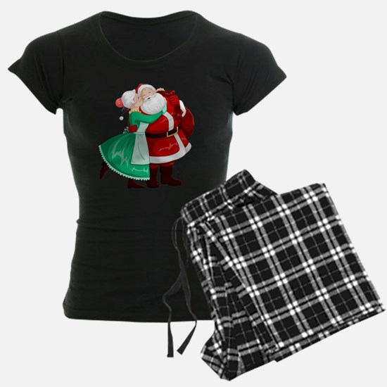 Mrs Claus Kisses Santa On Ch Pajamas