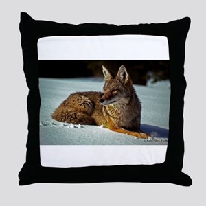 Coyote relaxing in the snow Throw Pillow