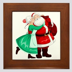 Mrs Claus Kisses Santa On Cheek And Hu Framed Tile