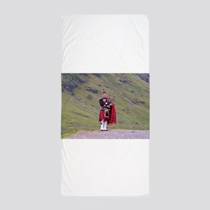 Lone Scottish bagpiper, Highlands, Sco Beach Towel