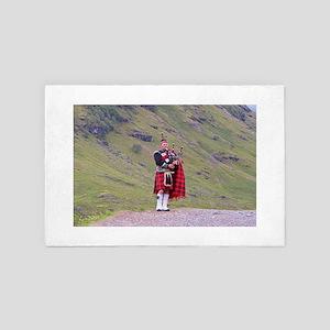Lone Scottish bagpiper, Highlands, Sco 4' x 6' Rug