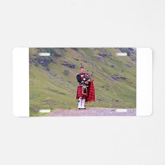 Lone Scottish bagpiper, Hig Aluminum License Plate
