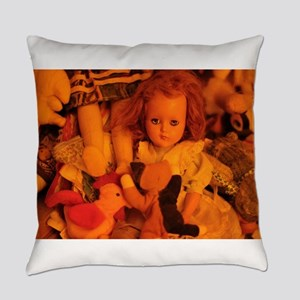 old doll in room of toys Everyday Pillow
