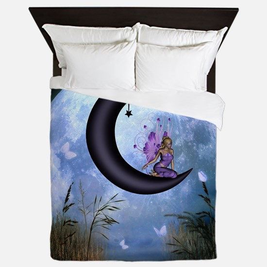 Beautiful fairy sitting on the moon in the night Q