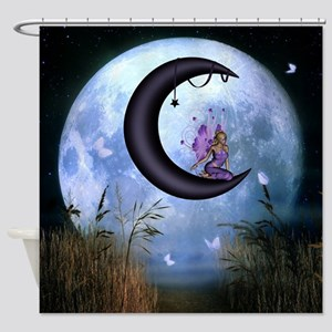 Beautiful fairy sitting on the moon in the night S