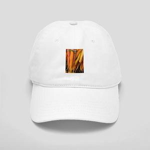 an assortment of long organic carrots in color Cap