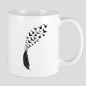 Black feather with birds Mugs