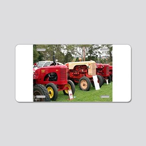 Vintage tractors in a line Aluminum License Plate