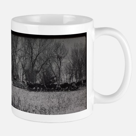 old farm scene with cows and truck Mugs