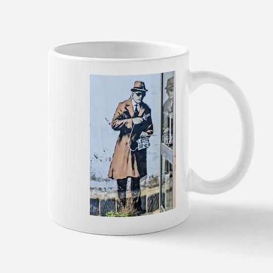 BANKSY SPY BOOTH CHELTENHAM Mugs