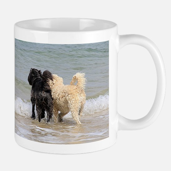 Two dogs at beach Mugs