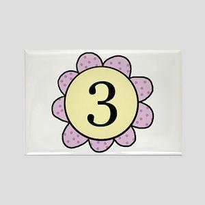 three purple/yellow flower magnet