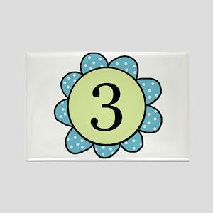 three blue/green flower magnet
