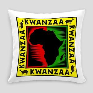Happy Kwanzaa Girl staring at the Kinara Every