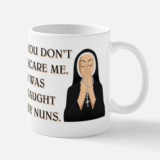 TAUGHT BY NUNS Mug