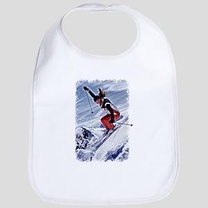 Skiing Down the Mountain in Red Bib