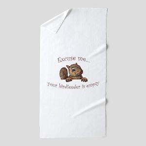 Excuse me...your birdfeeder is empty Beach Towel