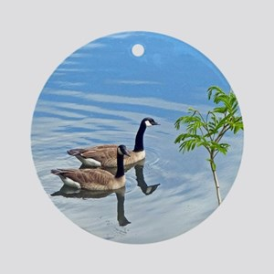 Swimming Geese Round Ornament