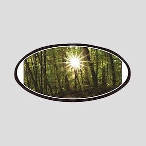 sun between woods Patch