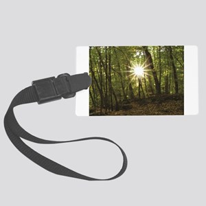 sun between woods Large Luggage Tag