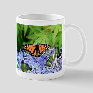 Monarch butterfly in garden Mugs