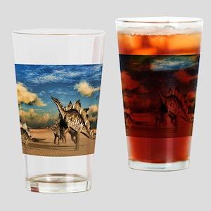 Stegosaurus dinosaur in the desert Drinking Glass