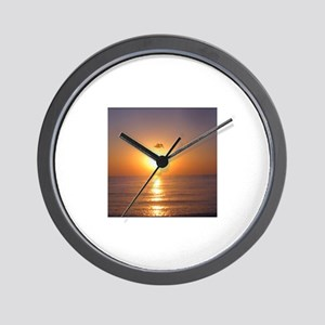 Pelican at sunset Wall Clock