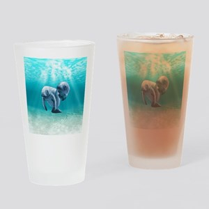 Two Manatees Swimming Drinking Glass