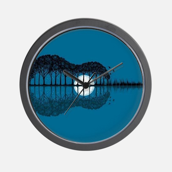 Trees sea and the moon turned guitar Wall Clock