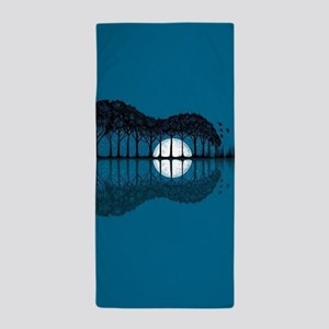 Trees sea and the moon turned guitar Beach Towel