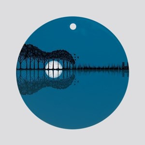 Trees sea and the moon turned guita Round Ornament