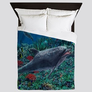 Dolphins play in the reef Queen Duvet