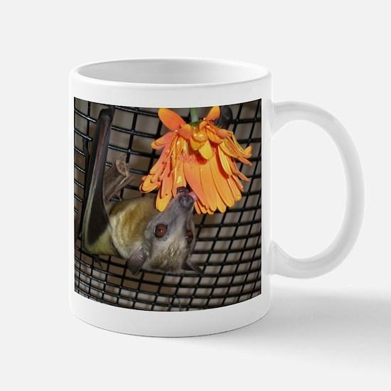 Fruit bat with flower Mugs