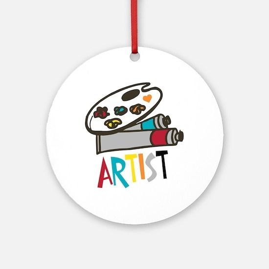 Artist Paints Round Ornament