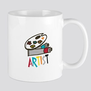 Artist Paints Mugs