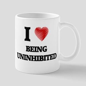 being uninhibited Mugs