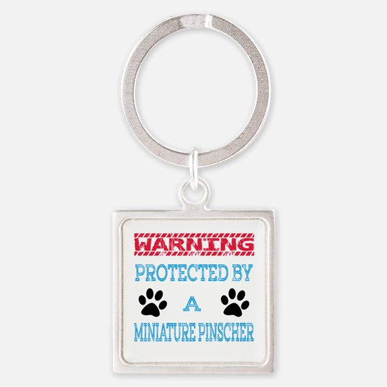 Warning Protected by a Miniature P Square Keychain