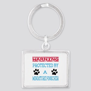 Warning Protected by a Miniatur Landscape Keychain