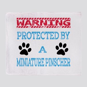 Warning Protected by a Miniature Pin Throw Blanket
