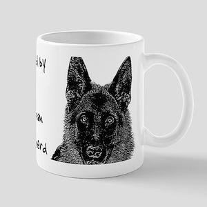 Owned by a German Shepherd Mugs