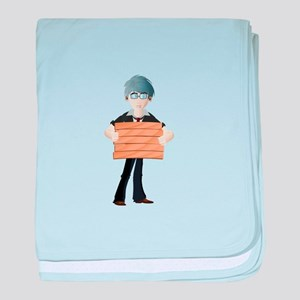 Young boy with wooden hording baby blanket