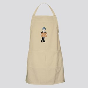 Young boy with wooden hording Apron